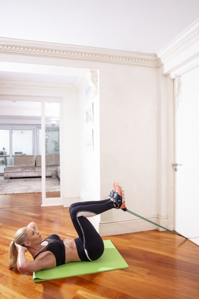 woman doing workout with resistance bands