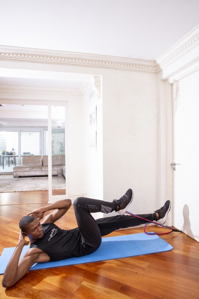 man doing workout with resistance bands