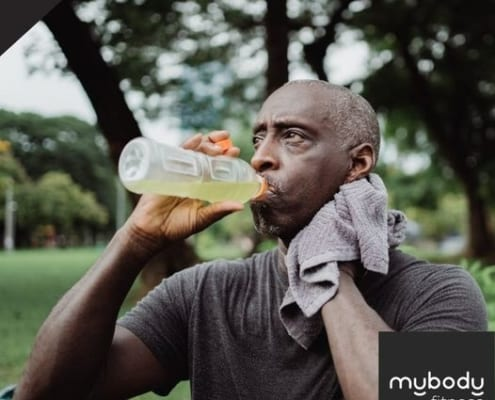 man drinking after gym session